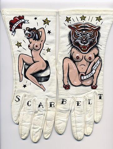 "Ellen Greene, ""Scar Belt Momma,"" 2010. Acrylic and ink on vintage gloves, wood and steel frame, 10.5""x13"""
