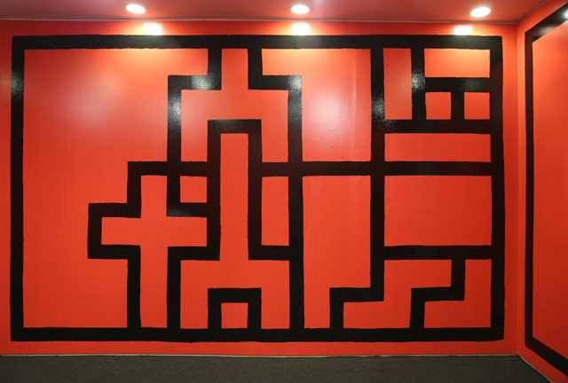 """G.T. Pellizzi, """"The Red and the Black"""" (2013), installation view, oil-based enamel on plywood (click to enlarge)"""