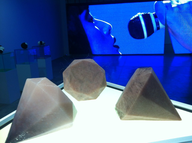 """An installation view of the """"ProBio"""" show, with Dina Chang's """"Flesh Diamonds"""" (2013) in the foreground and a video by Shanzhai Biennial in the background"""