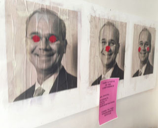 A poster in the Foundation Building lobby on Friday evening of Cooper Union president Jamshed Bharucha with clown accents.