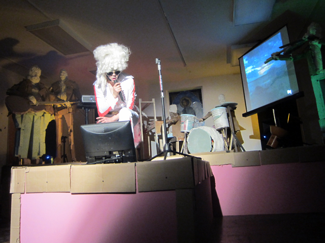 """Cate Giordano, """"Dolly Presley"""" performance, curated by Eve Sussman, with a plaster, foam, cardboard, and wood band and back up singers"""