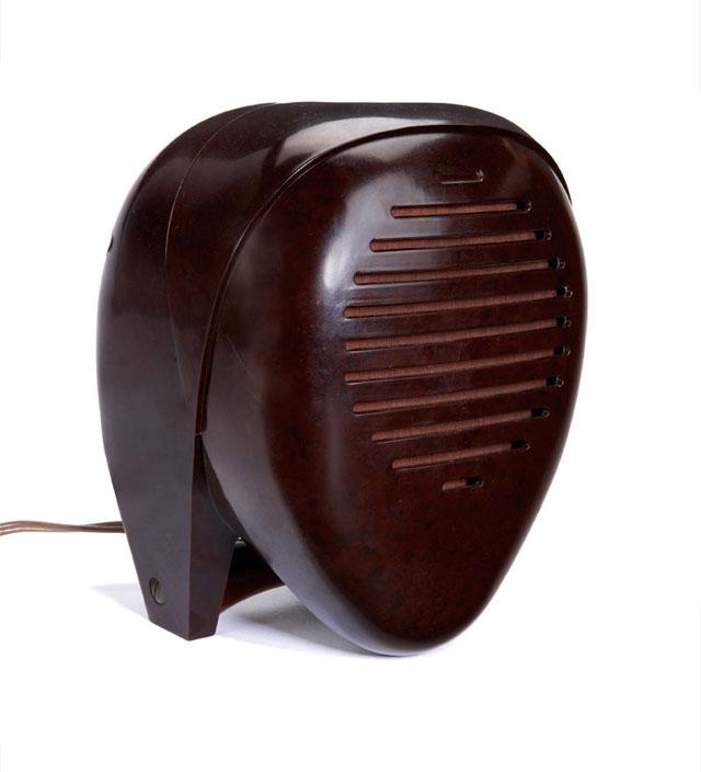 """Lot 358 Isamu Noguchi Radio Nurse 1937 Bakelite Zenith Radio Corporation Molded manufacturer's marks 8"""" x 6.5"""" x 5.5"""" Literature: von Vegesack, Alexander. Isamu Noguchi, Sculptural Design. Exhibition Catalogue. Weil am Rhein: Vitra Design Museum,2001. p 110. Estimate: $5,000 - $7,000"""