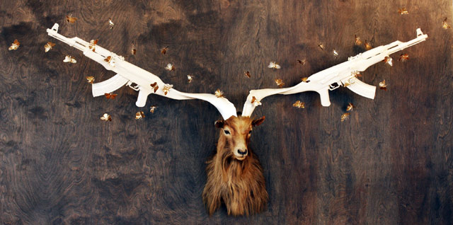 Peter Gronquist, One in a Million, 2013, mixed media with taxidermy and 24 karat gold, 40x30x15 inches