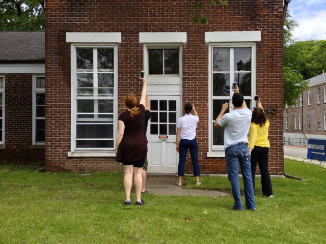 """In """"Fidgital Spring,"""" members of Hook and Eye Theater Company used their Facebook newsfeeds as performative guides during Fingment NYC on Governors Island."""