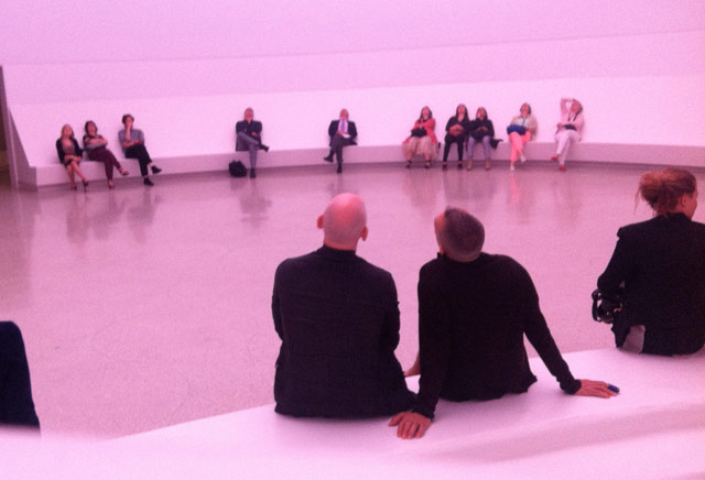 """Purple-tinted viewers take in """"Aten Reign"""" in the Guggenheim's lobby (photo by the author for Hyperallergic)"""