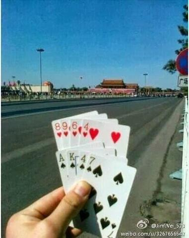 AK47 cards in Tiananmen Square (Via the Encyclopedia of Virtual Communities in HK)