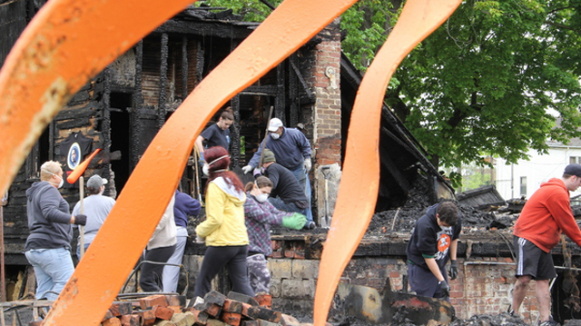 Volunteers cleaning up after the OJ House fire