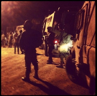 A soldier's shadowy Instagram photo of a nighttime raid (click to enlarge) (via electronicintifada.net)