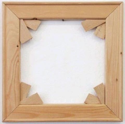 """Imi Knoebel, """"Keilrahmen"""" (1968–69), wood, 11.8 x 11.8 x 0.8 in / 30 x 30 x 2 cm (via Artnet)"""