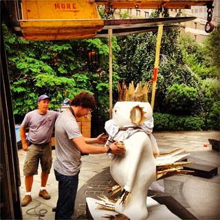 "Artist Olaf Breuning installing his work for Public Art Fund's ""Lightness of Being"" (via PAF on Instagram)"