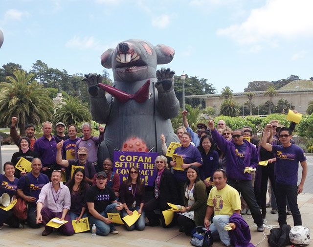 Members of SEIU Local 1021 with their inflatable rat last fall, when they were fighting with COFAM over their contract. (photo from anonymous source)