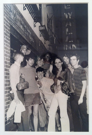 "Fred W. McDarrah's ""Celebration After Riots Outside Stonewall Inn"" (1969) is also on view in the show. Lanigan-Schmidt is on the far right. (click to enlarge)"