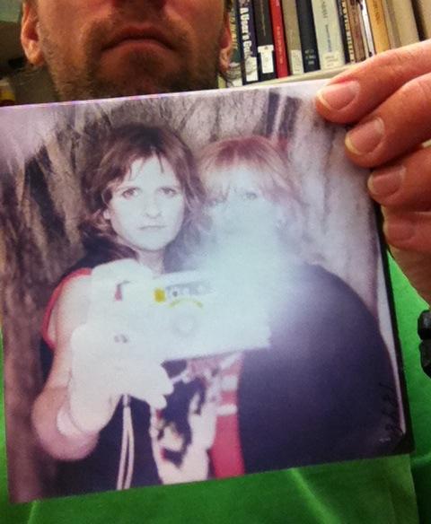 Timothy Garrison taking a photo of an Indigo Girls album