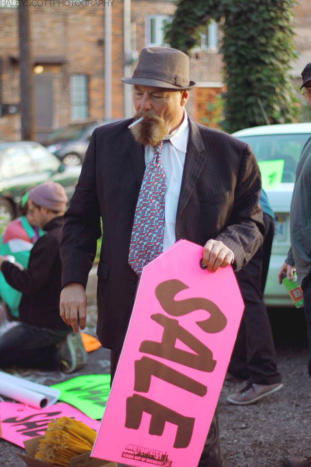 """Jerry Vile with one of the tag sale signs for his project """"The Selling of Detroit"""""""