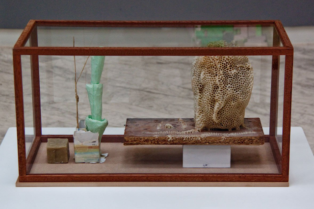 """Emil Westman Hertz, """"The New Face,"""" glass display cabinet with beeswax, pollen, dust, polystyrene, 71 x 36 x 36 cm, (2013)"""