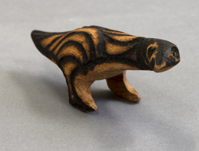Carved punu (bird with pokerwork design) from Ernabella Arts Inc. Central Australia.