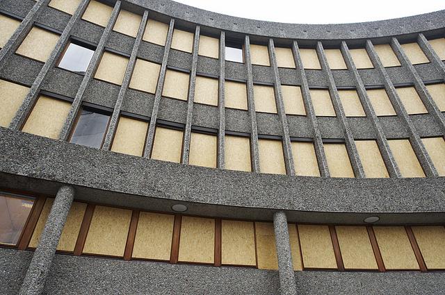 "Boarded up windows post-2011 bombing on the Erling Viksjø-designed building that has the Picasso ""Fishermen"" mural (viaRune Aakvik/Oslo Museum)"