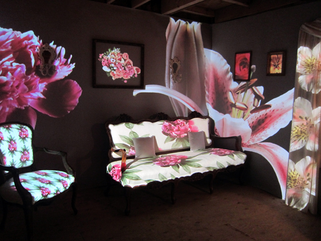 """Carmen Osterlye, """"Den of Blossomy"""" (2013), found furniture, two-channel video projection"""