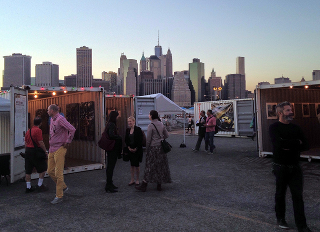 At Photoville, with the lower Manhattan skyline in the background. (all images by the author for Hyperallergic)