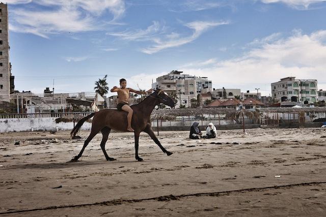 """Tanya Habjouqa, """"Gaza Beach"""" from the series """"Women of Gaza"""""""