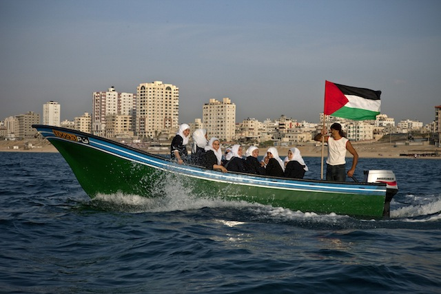 """Tanya Habjouqa, from the series """"Women of Gaza."""" Text for the photograph: """"High school students enjoy a field trip on the Mediterranean Sea off the Gazan coast---the ten minute boat ride an adventure as they are not allowed to travel outside of the Gazan enclave due to the siege."""""""