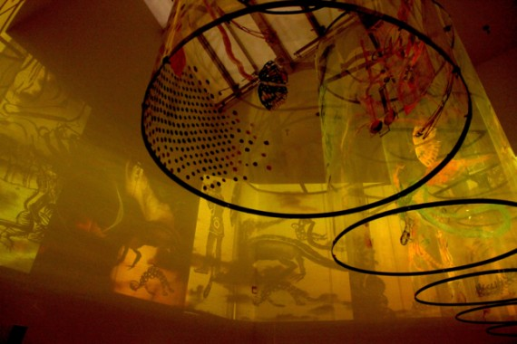 """Nalini Malani, """"In Search of Vanished Blood"""" (detail) (2012), six-channel video/shadow play with five rotating reverse painted Mylar cylinders, sound, running time: 11 minutes, variable dimensions (via galerielelong.com)"""