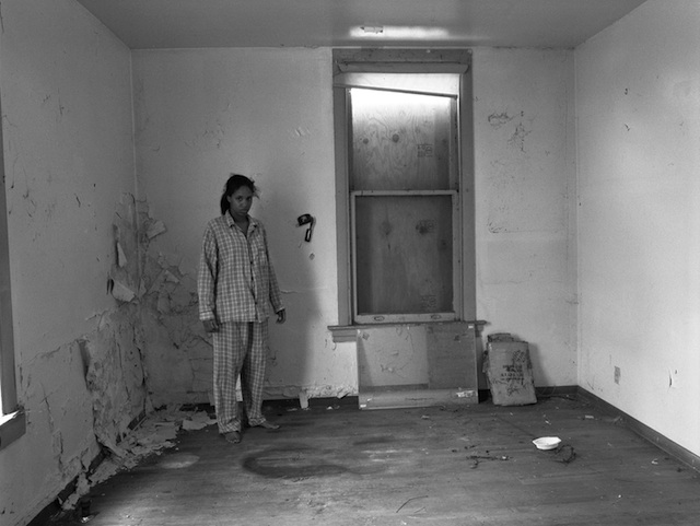 """LaToya Ruby Frazier, """"Self Portrait In Gramps' Pajamas, (227 Holland Avenue)"""", 2009, 20 x 24 inches. Silver Gelatin Print. Courtesy of the artist and Galerie Michel Rein, Paris."""