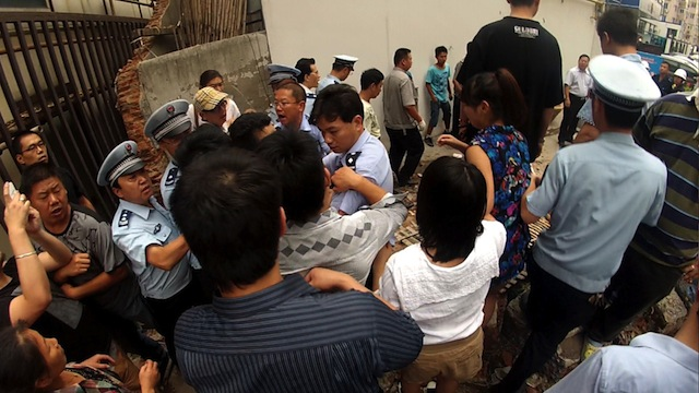 A view of the scuffle outside of the Yuan Gong's studio building.