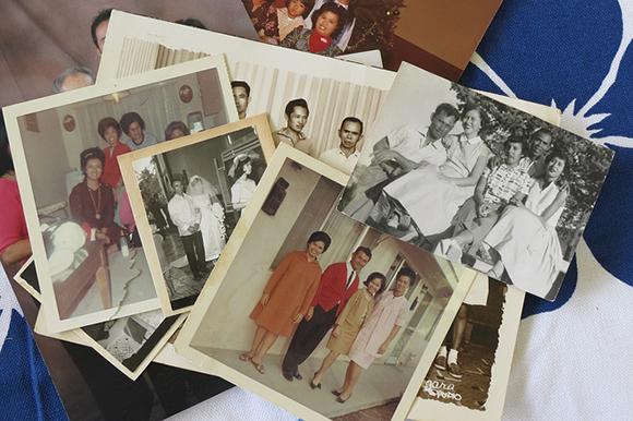 Lapiz family photos waiting to be digitized. | Photo: Catherine Trujillo, from the family album of Arcadia Lapiz. Courtesy of The Re/Collecting Project. California Polytechnic State University, San Luis Obispo. (http://reco.calpoly.edu)