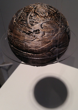 A 3D printed sphere hangs in the gallery.