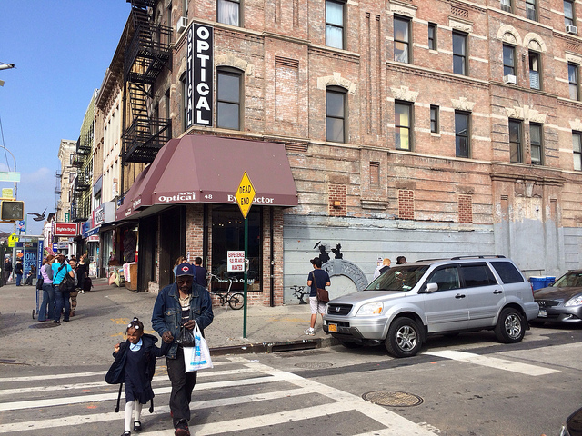 A view of the Banksy at the corner of Graham Avenue and Cook Street (all photos by the author for Hyperallergic)