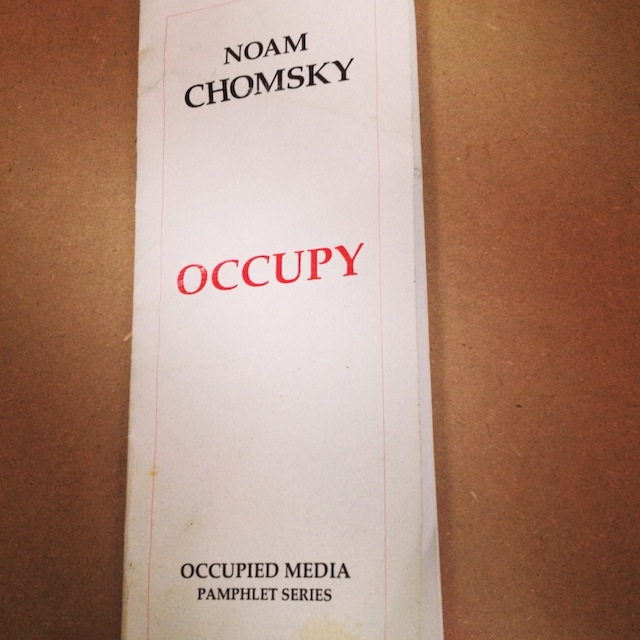 Chomsky OCCUPY pamphlet from Mattthias Neumann's The People's Library at the Public Museum (2011-2013). Photograph by the author for Hyperallergic.