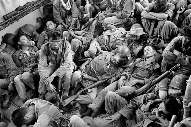 """Horst Faas, """"Exhausted South Vietnamese Soldiers Sleep on a U.S. Navy Troop Carrier Taking them Back to the Provincial Capital of Ca Mau"""" (August 1962), gelatin silver, printed 2013, 16 x 20 in (via stevenkasher.com)"""