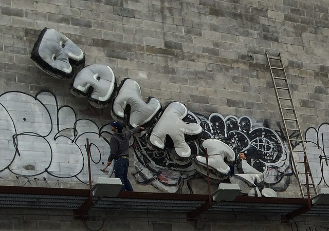 The Banksy coming down.