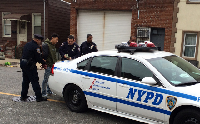 Another man arrested for what appeared to be obstructing police activity.