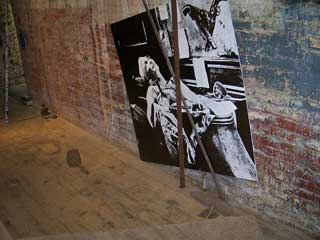 "Allen Brewer and Pamela Valfer, ""Ad infinitum"" (detail) (2013), graphite on venetian plaster, wood, carpet flooring, dimensions variable (click to enlarge)"