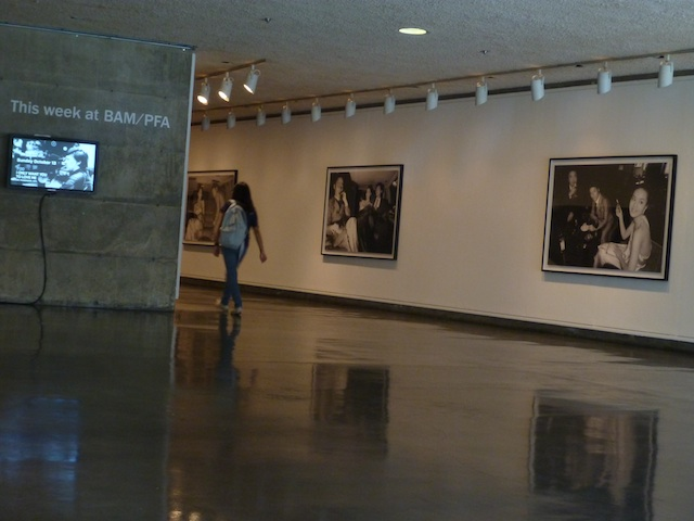A visitor walks past Yang's black and white photographs depicting urban Shanghainese youth.