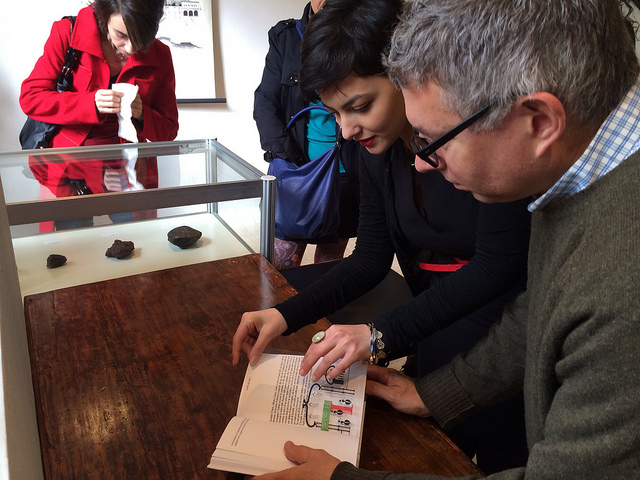 Artist Mark Dion looks at Siena Art Institute student Serena Cestari's typographic translation of Italo Calvino's Invisible City. (alll photos by the author for Hyperallergic)