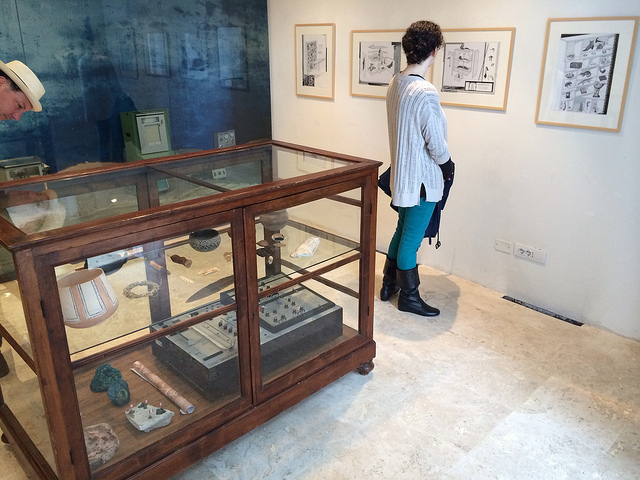 """A display case of 3D printed objects and collaborative drawings by Amy Yoes and Mark Dion on display at the """"Above/Below Ground"""" exhibition in Siena."""