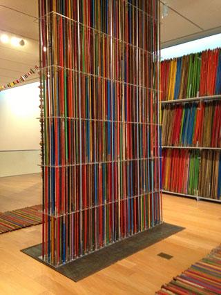 "Thomas Glassford, ""Broomsticks"" (2013), 7,000 wood broomsticks, library shelves"