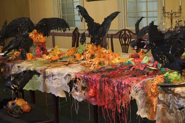 """Detail of Valerie Hegarty's """"Tablecloth with Fruit and Crows"""" (2013), in the Cane Acres Plantation dining room"""