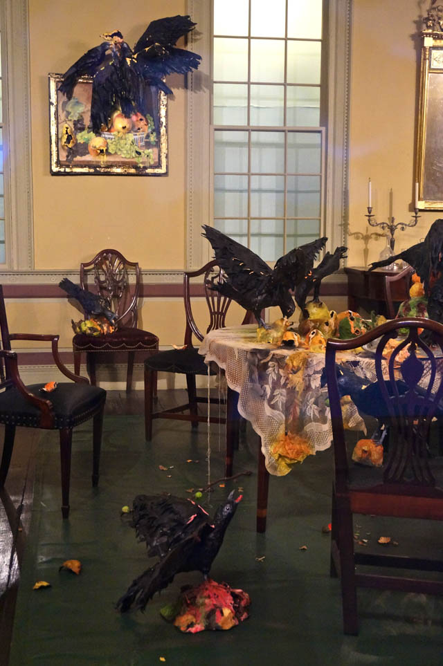 """Details of Valerie Hegarty's """"Tablecloth with Fruit and Crows"""" (2013) and """"Still-Life Paintings with Crows"""" (2013), in the Cane Acres Plantation dining room"""