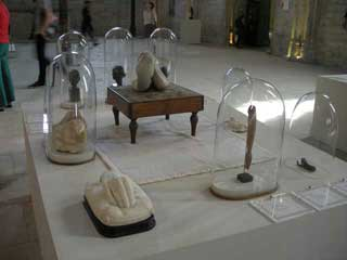 Vitrines filled with relics and work by the artists (click to enlarge)