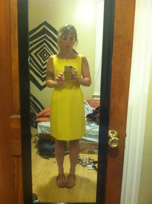 Lisa Yanni snaps a selfie of herself in a dress that she found at a thrift store and prettied up for a wedding.