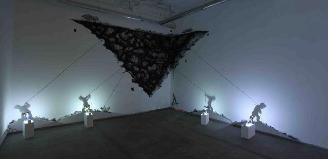 """""""Heroes of the Sataranga Collective"""" (2013), Clay Sculptures, LED Lights, Shadow projection and Charcoal drawings on the wall, Installation view"""
