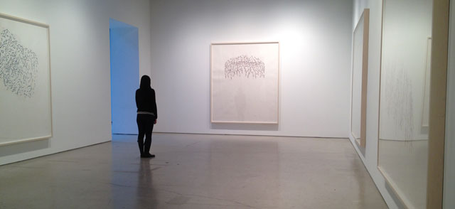 Attendant at Hauser + Wirth, New York City, views Roni Horn's But 3 (2013), to her left is But 1 (2013).