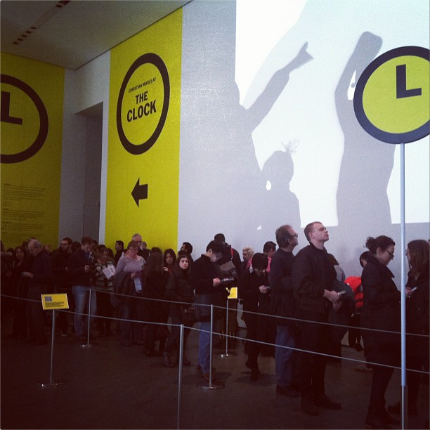 """Visitors waiting to see """"The Clock"""" at MoMA (photo by Jillian Steinhauer for Hyperallergic)"""