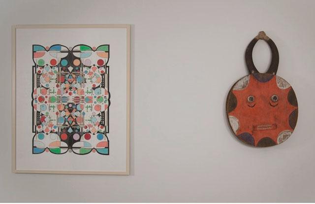 "Glendalys Medina's ""Alphabet Series: #8 of 26 (H)"" (2012) alongside a Goli Mask from the Ivory Coast (early 20th century) (photo courtesy Coworker Projects)"