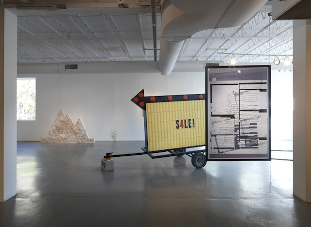 """From left to right: Assaf Evron, """"Untitled (Egyptian Embassy Tel Aviv),"""" 2013. Dry wall, split-face blocks, and acrylic. 6' x 5'; Conrad Bakker, """"Untitled Project: SIGN [Relax and Take Your Fucking Time],"""" (2013), oil paint on carved wood, 82 x 108 x 58 inches; Aaron Van Dyke, """"Untitled"""" (2013), inkjet print (double-sided), 42 x 64 inches. All images courtesy of Hyde Park Art Center unless otherwise noted."""