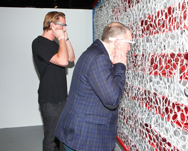 """Viewers wearing Google Glass and interacting with David Datuna's """"Portrait of America"""" (2013)"""